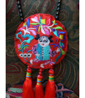 Wonderful important ethnic necklace with an embroidered round and 3 red pompoms